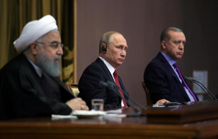 Iran's President Rouhani together with his counterparts Putin and Erdogan attend a joint news conference following their meeting in Sochi